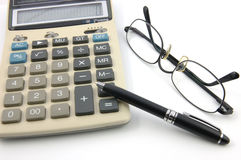 Eyeglasses, pen and calculator Royalty Free Stock Image
