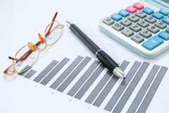 Eyeglasses, pen, chart document and calculator Stock Image