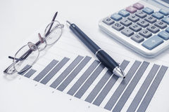 Eyeglasses, pen, chart document and calculator Royalty Free Stock Image