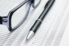 Eyeglasses and Pen on Top of Report Papers Royalty Free Stock Photos