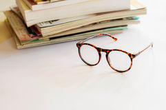 Eyeglasses with pile of books Stock Photography