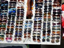 Eyeglasses retailer. Praia a Mare, Cosenza, Calabria, Italy - June 3, 2017: Beach Walker with its Sunglasses Exhibitor Royalty Free Stock Image