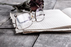 Eyeglasses and rose Royalty Free Stock Photos