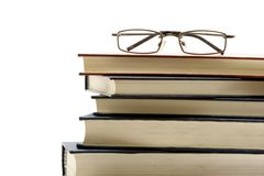 Eyeglasses on school books Stock Photo