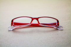 Eyeglasses. On seamless brown paper background Royalty Free Stock Photography