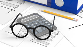 Eyeglasses set on desktop with paperwork Royalty Free Stock Photo