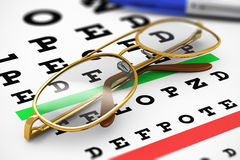Eyeglasses and Snellen vision test Stock Photo