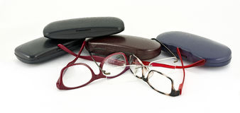 Eyeglasses and some hard shell cases Royalty Free Stock Image