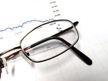 Eyeglasses and Stock Chart Stock Images