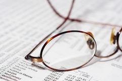 Eyeglasses on stocks Stock Photo