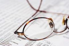 Eyeglasses on stocks. Eyeglasses on the table Stock Photo