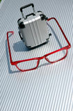 Eyeglasses and suitcase 5 Stock Photos