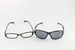 Eyeglasses and sunglasses. Eyeglasses and sunglasses isolated on white royalty free stock images