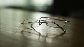 Eyeglasses on table Royalty Free Stock Photo