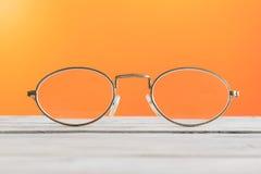 Eyeglasses on a table Royalty Free Stock Photos