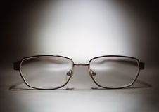 Eyeglasses on a table Royalty Free Stock Images