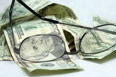 Eyeglasses to see your cash. Business glasses stock photos