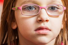 Closeup of young toddler girl in eyeglasses Stock Image