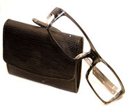 Eyeglasses and wallet Stock Photos