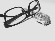 Eyeglasses and watch