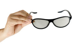 Eyeglasses in woman's hand Stock Image