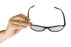 Eyeglasses in woman's hand Royalty Free Stock Photo