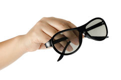 Eyeglasses in woman's hand Royalty Free Stock Image