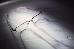 Eyeglasses on a wooden table. Close up photo Stock Photo
