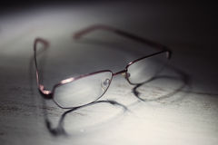 Eyeglasses on a wooden table. Close up photo Royalty Free Stock Photos
