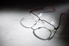 Eyeglasses on a wooden table Royalty Free Stock Images
