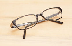 Eyeglasses on wooden table. Isolated Stock Image