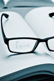 Eyeglasses and word love in a notebook, in duotone Stock Photography