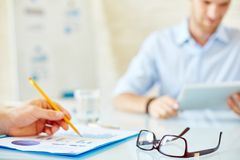 Eyeglasses on workplace Royalty Free Stock Image