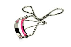 Eyelash curler. Picture of eyelash curler with white background Stock Photo