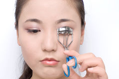 Eyelash curler. Beautiful girl with eyelash curler Stock Image