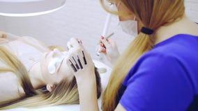 Eyelash extension procedure in beauty salon stock video footage