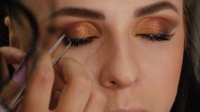 Eyelash Extension Procedure. Female eye with long eyelashes. Eyelashes, close up, macro stock footage