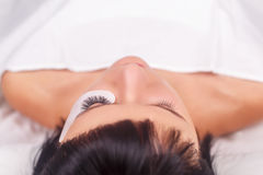 Eyelash Extension Procedure. Woman Eye with Long Eyelashes. Lashes, close up, selected focus. Eyelash Extension Procedure. Woman Eye with Long Eyelashes. Lashes Royalty Free Stock Photography