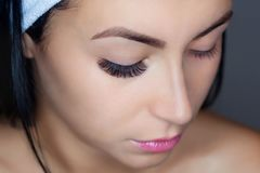 Eyelash removal procedure close up. Beautiful Woman with long lashes in a beauty salon. stock photos