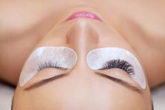 Eyelash removal procedure close up. Beautiful Woman with long lashes in a beauty salon stock image