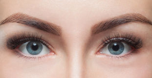 Eyelash removal procedure close up. Beautiful Woman with long lashes in a beauty salon stock photos