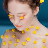 Eyelashes like petals of flowers. Beautiful young girl in the image of flora, close-up portrait royalty free stock images