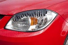 Eyelashes over Car Headlight Royalty Free Stock Image