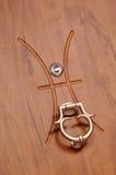 Eyelet. Steel door eyelet detail with metal knob royalty free stock photos