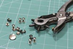 Eyelets. Closeup of a eyelet tool Royalty Free Stock Image