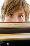 Eyelevel view of boy with books Stock Images