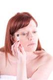 Eyeline. Woman applying her make up Royalty Free Stock Photography