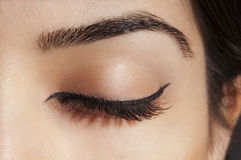 Eyeliner on Closed Eye. Close up photo of a female eye with simple eye liner make up Stock Photography