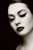 Eyeliner and false lashes. Duotone portrait of young beautiful woman with eyeliner and false lashes Stock Images