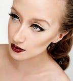 Eyeliner und rote Lippen Stockfoto